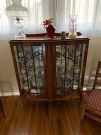 Antique hutch with mirrored back.