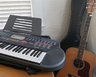 Electronic keyboard and acoustic guitar