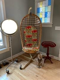 "Hanging chair, fun ""spot light"" floor lamp, tractor seat stool."