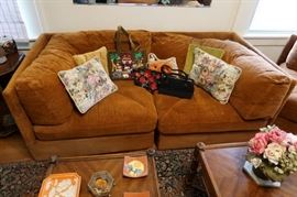 Tribal rug, small occasional tables.