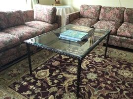 Two matching sofa and glass coffee table
