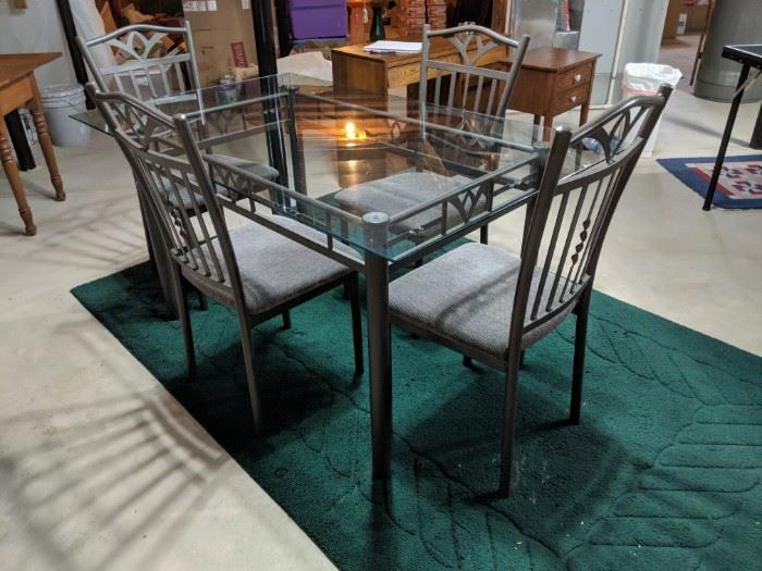 $175   Rectangular glass table with four chairs