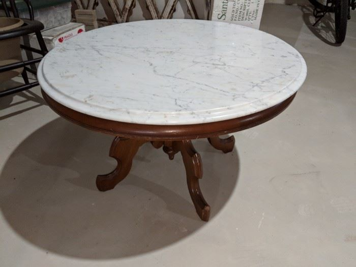 $60  Marble top, wood base table