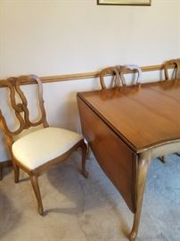 Drop leaf dining room table with 6 chairs and table covers