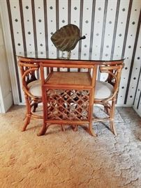 Rattan glass topped table with 2 pullout chairs