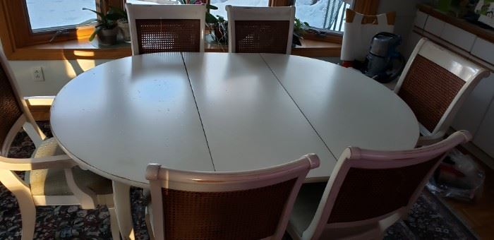 Dining room table comes with 2 leaves, also same color as the buffet server