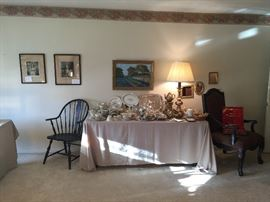 This table in the living room contains silver plate and a beautiful set of Noritake china. Japanese tea set and vintage flatware