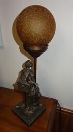 Metal figural organ grinder lamp.  Intact and working