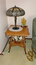 Wonderful Morning Glory antique slag glass lamp.  Nice claw foot table too!