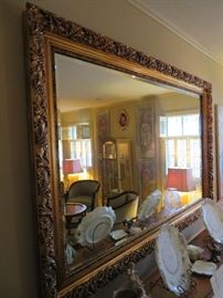 VERY LARGE AND ORNATE MIRROR WITH GILT FRAME