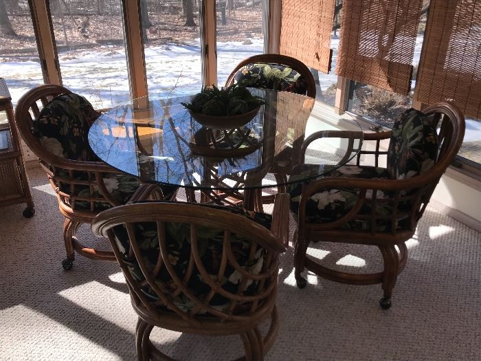Rattan/Bamboo table with glass top and 4 chairs on casters with cushions