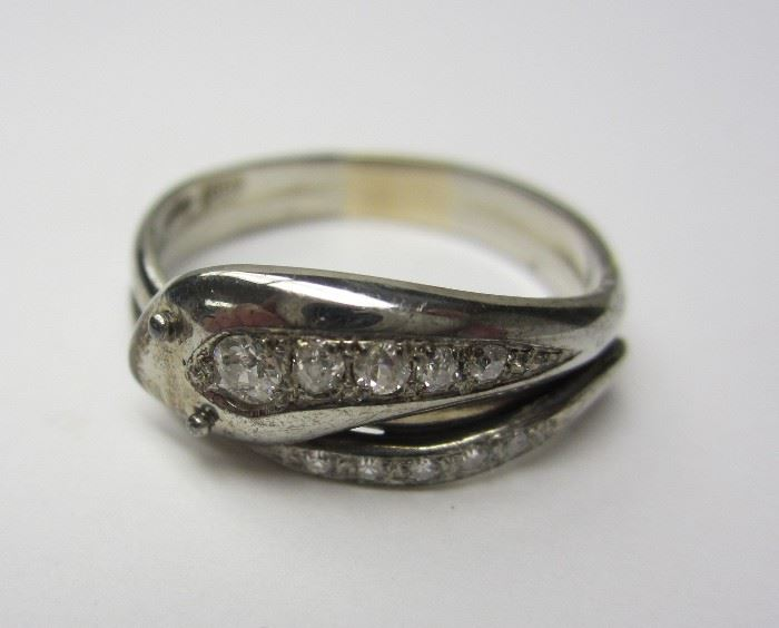 14k white gold ring.  Snake form with graduated diamonds