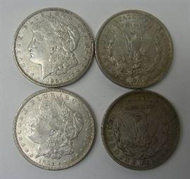 Four XF Morgan silver dollars