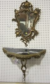 Rococo style metal wall shelf and mirror with marble top.  Brought from and East coast estate.