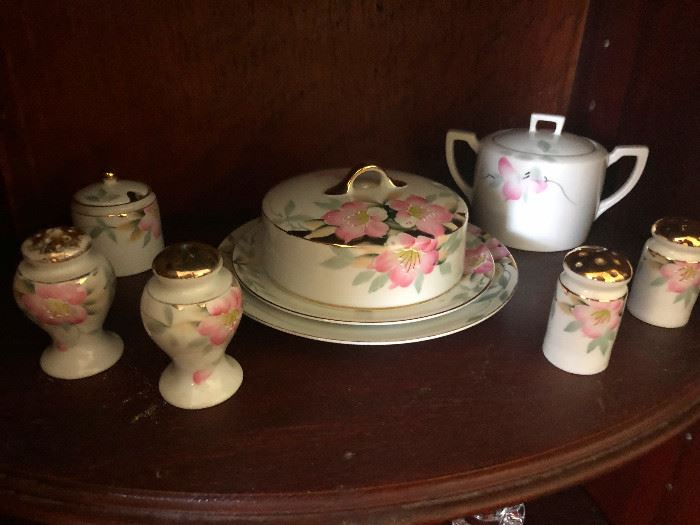 gold-rimmed painted porcelain serving items