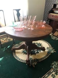 Lovely cherry ball and claw dining table with leaf. Area rug
