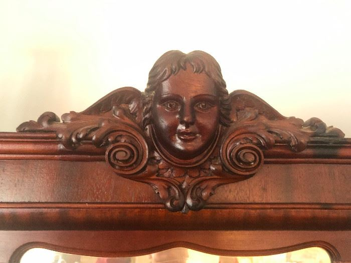 Close-up of carved Cherub on Secretary. You need this staring at you as you eat!