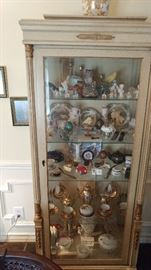 offwhite curio cabinet has matching buffet