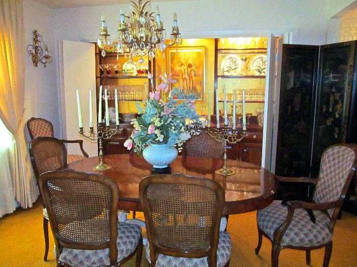 WALNUT DINNING TABLE WITH 2 EXTENSIONS 6 SIDE CHAIRS AND 2 ARM CHAIRS, BRASS CANDELABRAS