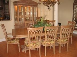 """Blonde wood dining table  w/ 2 leaves (16"""" each)"""" 8 dining chairs: 2 arm and six side chairs"""