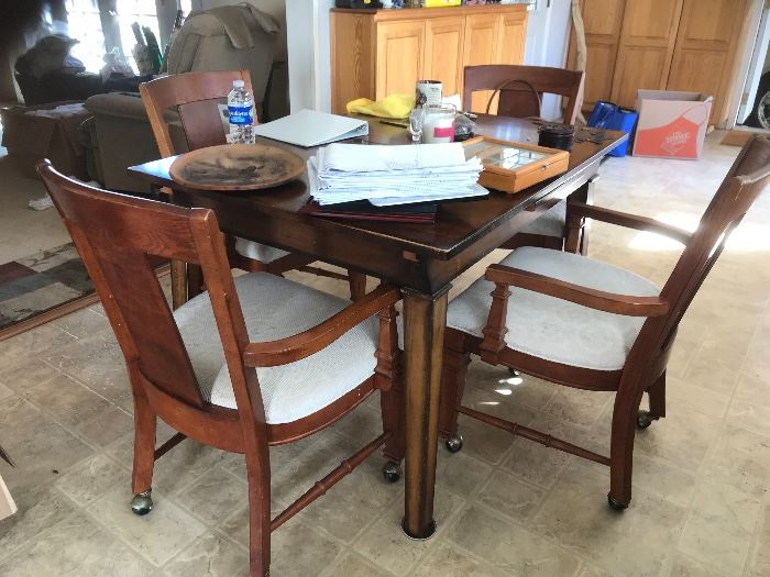 Kitchen table and rolling chairs. All wood