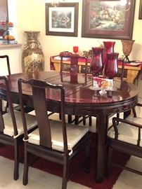 Beautiful like new rosewood Asian dining table with six chairs and two leaves.   On back wall is an old Traditional  Chinese prayer/alter table.  Huge beautiful Asian floor vase