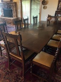 Antique Dining Table with 10 Barley twist and cane chairs