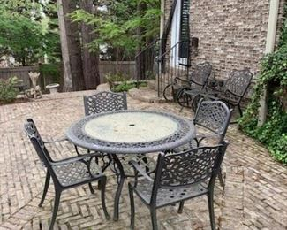 Outdoor cast aluminum dining set with marble top.
