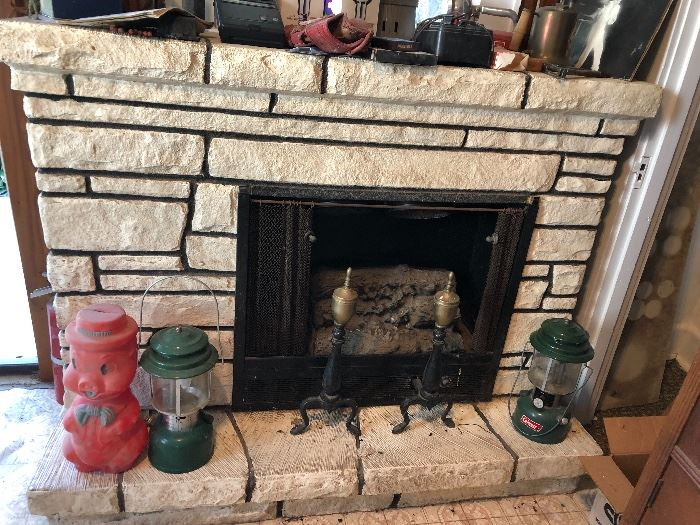Electric fireplace, Coleman lanterns, andirons