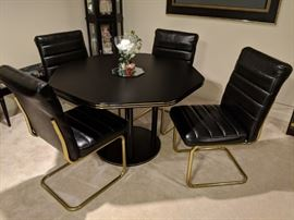 $125. Black octagon table with four black leather chairs