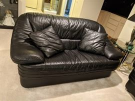 $100. Black leather loveseat