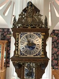 Delft clock with brass. Atlas with weight of world on top