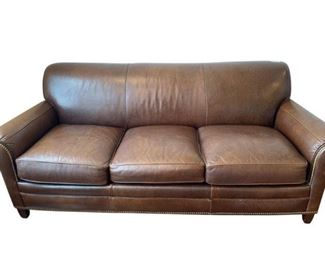 Elegant Hancock and Morre, leather sofa with nail head trim.