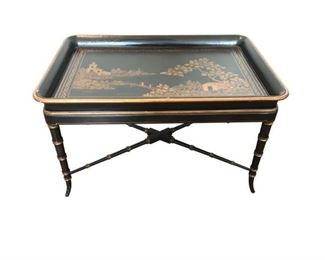 Stunning oversized, high-quality Chinoiserie tray table, black and gold finish. Wonderful piece to be used as an accent throughout the home. The tray lives off the base and can be used in different ways to excess arise or on the bed for display.