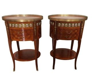 Lovely pair of Italian oval side tables, with two drawers and shelves, with brass accent surround. The old world parquetry and hand cut wood inlay is what sets Italian furniture, the finest in the World