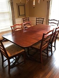 #10	double pedestal dining table w 1 leaf and pads 8 chairs 62-78x42x30	 $450.00