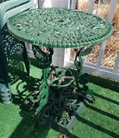 Vintage wrought iron patio table with umbrella stand
