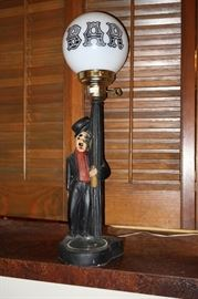 Vintage metal lamp; man on a  bar light