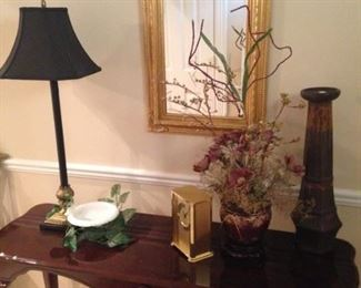 Sofa table, mirror, and accessories