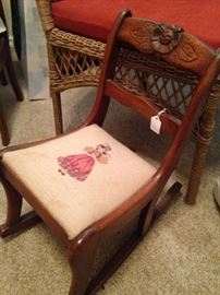 Duncan Phyfe style child's rocker with needlepoint girl seat