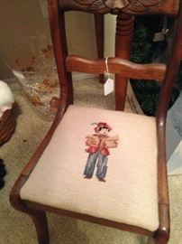 Duncan Phyfe style child's straight chair with needlepoint boy seat