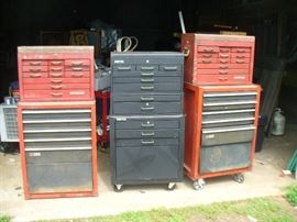 Many roll away tool boxes including Craftsman