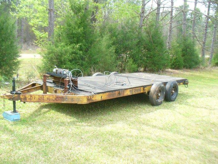 Heavy duty double axle trailer with heavy duty winch. Hauls cars, tractors heavy equipment