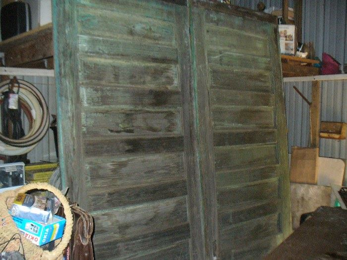 Antique pair of cotton warehouse doors 8 feet tall!!  from Leslie Georgia have all original cast iron rollers/hangars. original surface 115 years old. Would make awesome tables