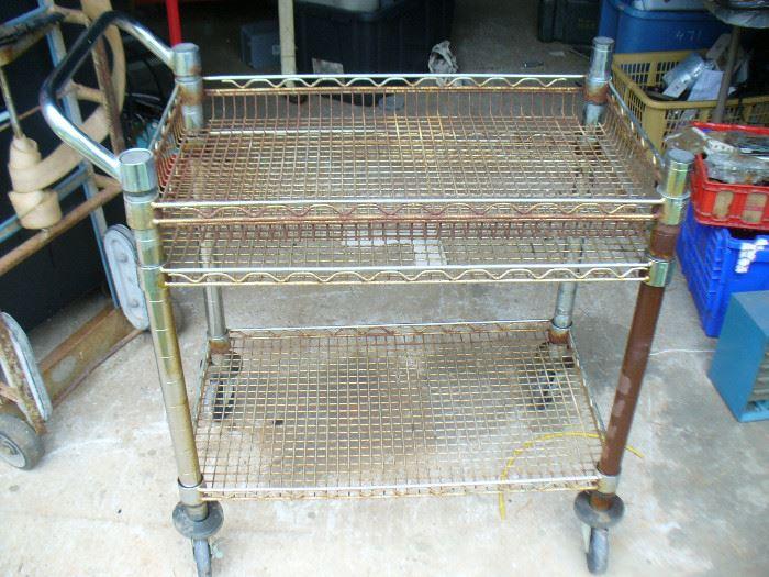 1940's metal cart with swivel wheels