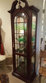 Two of these curio cabinets