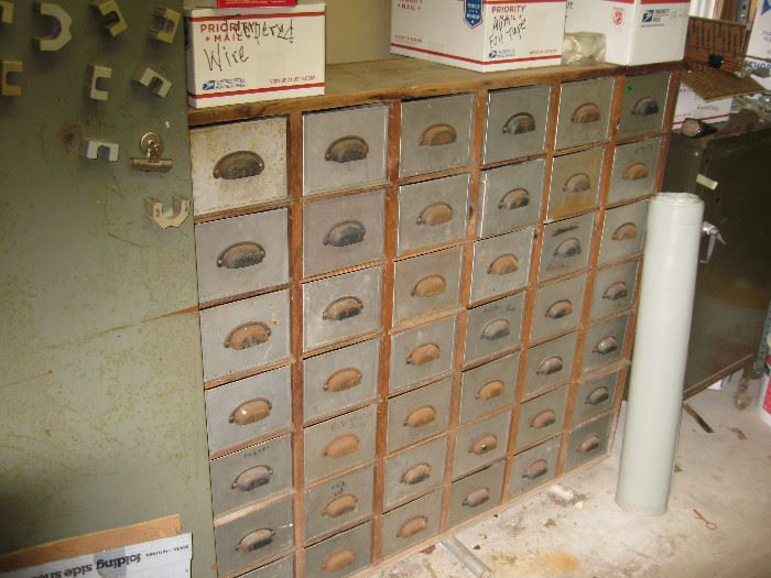 Large vintage metal and wood storage unit.  Great magnets, too.