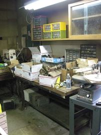 Multiples workbenches, some with vises.  Multiple small storage cabinets.