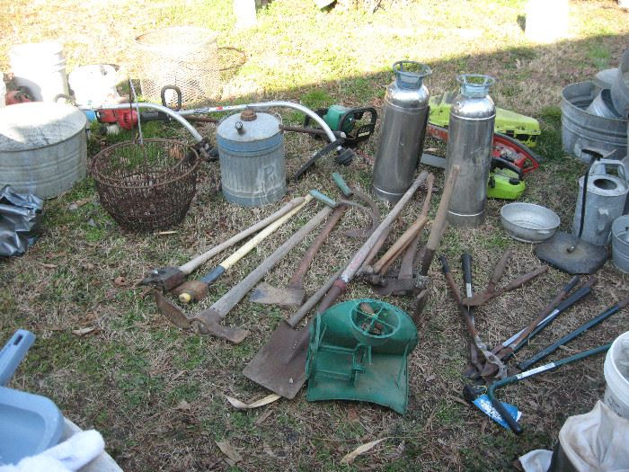 Axes, hatchets, wire baskets, old fire extinguishers, and more galvanized containers...