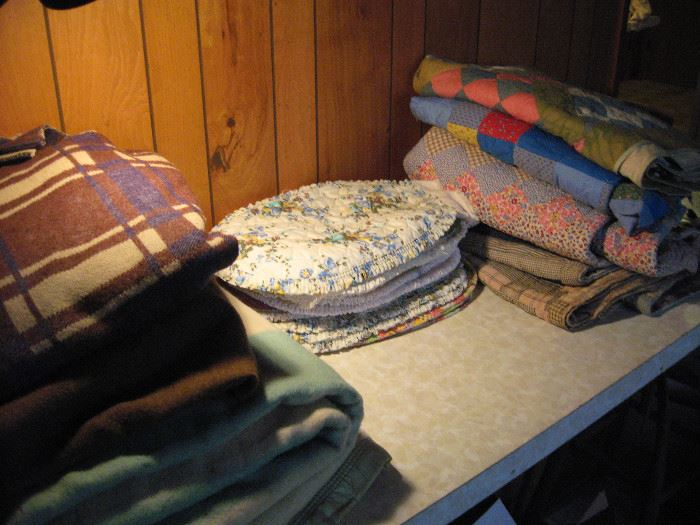 Just a few household items.  Old wool blankets, quilts, and placemats.